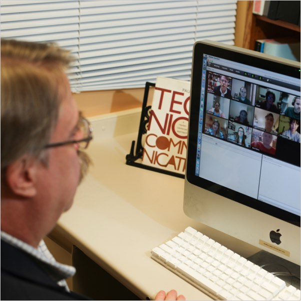 Students communicating with instructor remotely via their PCs in a live, fully online class.